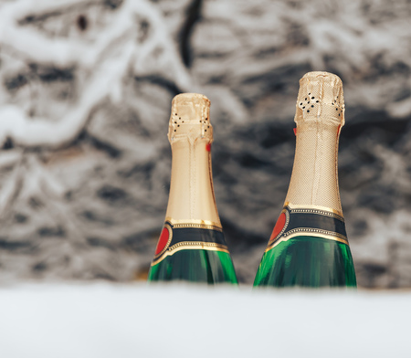 A bottle of sparkling wine in the snow Stock Photo