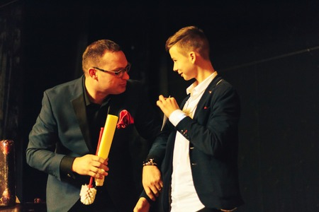 MINSK, BELARUS November 5 2017 International Illusion Festival MAGIC 2017 Seminar A young magician with an assistant shows the performance on stage Editorial