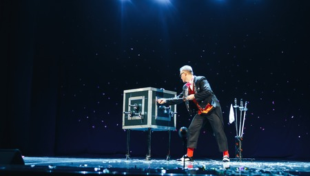 MINSK, BELARUS November 5 2017 International Illusion Festival MAGIC 2017 Concert dedicated to the festival MAGIC 2017 The male magician shows the performance on stage Editorial