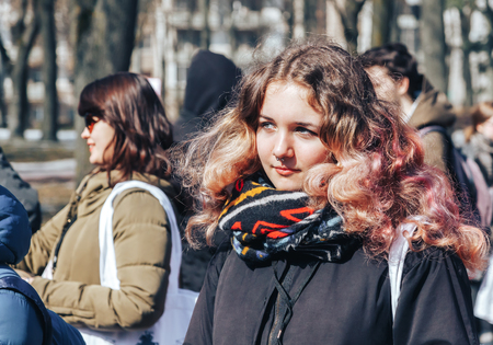 Minsk, Belarus. March 25, 2018 A holiday dedicated to the 100th anniversary of the founding of the Belarusian Peoples Republic Girl stands outdoors