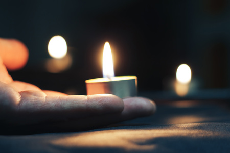 Memorial Day International Holocaust Remembrance Day On the day of the memory of the dead a hand holds a candle Stock Photo