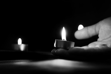 Memorial Day International Holocaust Remembrance Day On the palm of your hand a candle burns on the day of remembrance