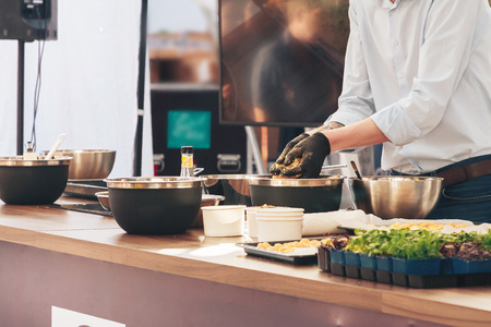 June 1, 2019 Festivities in the city on the day of Swedish culture Cook prepares food on a demo advertisement.