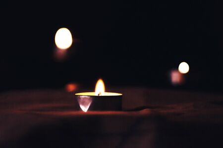 Candles burn in the night in memory of the dead