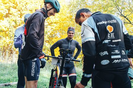 October 14, 2018, Minsk, Belarus.2018 Olympic Cross Country Cup XCO in Medvezhino Cyclists discuss the characteristics of the bike in the park.
