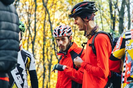 October 14, 2018, Minsk, Belarus.2018 Olympic Cross Country Cup XCO in Medvezhino Cyclists discuss the passage of the track after the race in the park