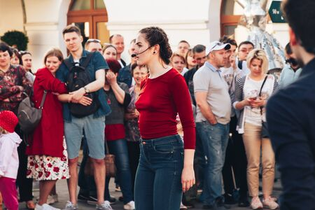 May 25, 2019 Minsk Belarus Street festivities in the evening city Artists man and woman show that they are tied with one red ribbon in front of people on the street Editorial