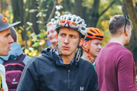 October 14, 2018, Minsk, Belarus.2018 Olympic Cross Country Cup XCO in Medvezhino A serious-faced cyclist stands among other athletes in the park.