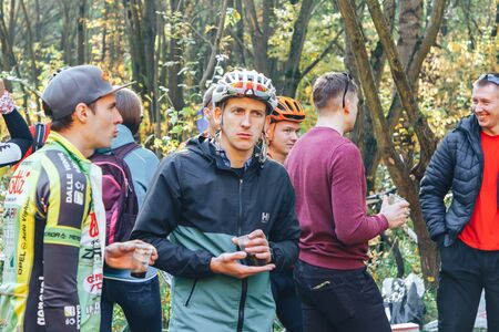 October 14, 2018, Minsk, Belarus.2018 Olympic Cross Country Cup XCO in Medvezhino Cyclists talking in the park