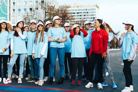 September 15, 2018 Minsk Belarus Half Marathon Minsk 2019 Young beautiful people in blue and red jackets stand on the road before the start