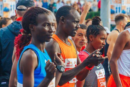 September 15, 2018 Minsk Belarus Half Marathon Minsk 2019 Athletes of different skin colors prepare for the start of the marathon