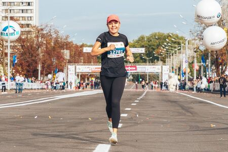 September 15, 2018 Minsk Belarus Half Marathon Minsk 2019 Happy woman runs a marathon on the road