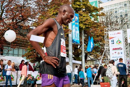 September 15, 2018 Minsk Belarus Half Marathon Minsk 2019 Tired athlete tries to catch his breath after the finish of the marathon