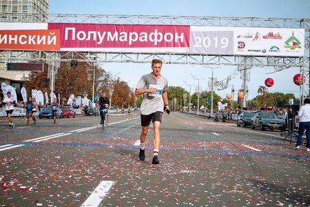 September 15, 2018 Minsk Belarus Half Marathon Minsk 2019 A tired athlete in a wet shirt crosses the finish line