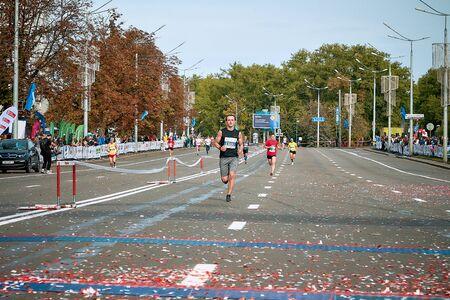 September 15, 2018 Minsk Belarus Half Marathon Minsk 2019 Athlete runs along the road strewn with confetti