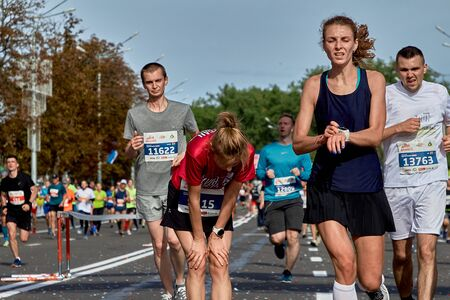 September 15, 2018 Minsk Belarus Participants of the Minsk half marathon 2019 recovers after crossing the finish line Editorial