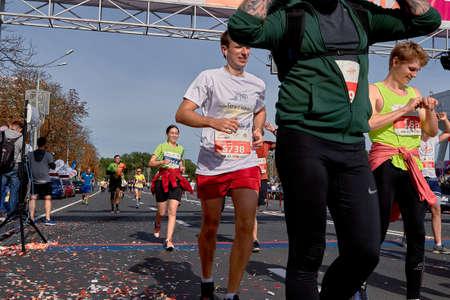 September 15, 2019 Minsk Belarus Many runners running after the finish line marathon. Healthy lifestyle.