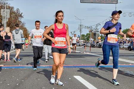 September 15, 2019 Minsk Belarus Half Marathon Minsk 2019 Participants crossing the finish line marathon on paved road in town.