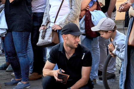 May 25, 2019 Minsk Belarus Young father talking with his little son at a street concert
