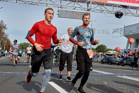 September 15, 2019 Minsk Belarus Competitors cross the finish line on an asphalt road in the city