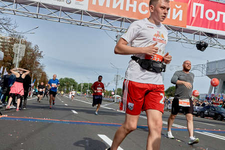 September 15, 2019 Minsk Belarus Young athlete with sweat drops on his face crossed the finish line of the marathon Éditoriale