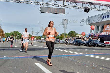 September 15, 2019 Minsk Belarus Athlete woman crossed the finish line of the marathon. Éditoriale