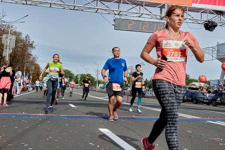 September 15, 2019 Minsk Belarus Marathon runners cross the finish line on an asphalt road Éditoriale