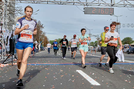 September 15, 2019 Minsk Belarus Active happy participants cross the finish line on the city road
