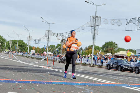 September 15, 2019 Minsk Belarus A woman crosses the finish line of a marathon on a city road
