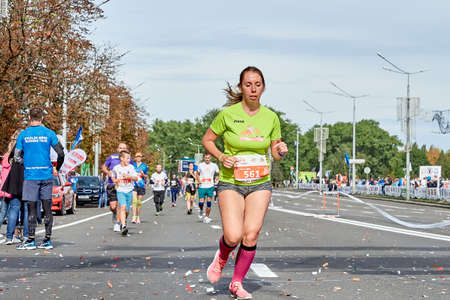 September 15, 2019 Minsk Belarus Close-up of a female runner running a marathon on a city road