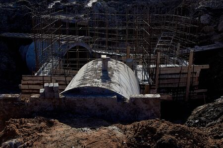 Reinforced concrete drainage pipes include a monolithic chamber for the construction of storm sewers. Metal products for monolithic construction at a construction site.