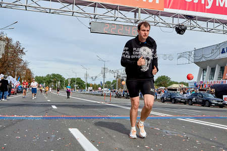 September 15, 2019 Minsk Belarus Three marathon runners cross the finish line on a city road