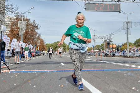September 15, 2019 Minsk Belarus A mature woman crossed the finish line of the marathon.