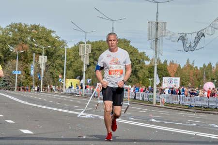 September 15, 2019 Minsk Belarus An older man runs a marathon on a city road