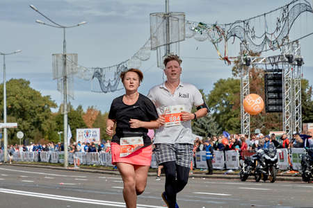 September 15, 2019 Minsk Belarus A marathon race in which a man and a woman run along a city road