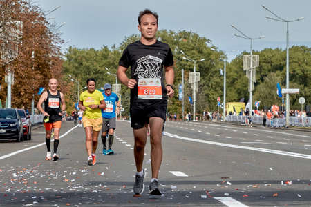 September 15, 2019 Minsk Belarus Close-up of a participant running on a city road marathon ahead of all athletes