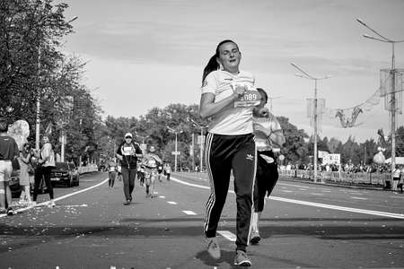 September 15, 2019 Minsk Belarus A marathon race in which an active woman jumps while running on a city road