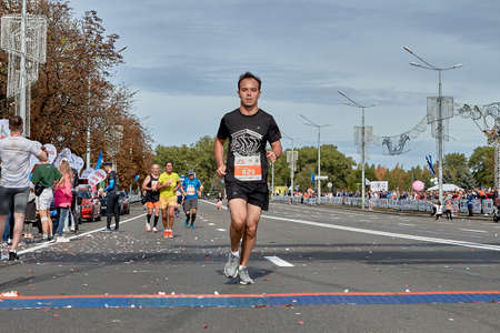 September 15, 2019 Minsk Belarus The participant runs to the finish of the marathon ahead of all athletes