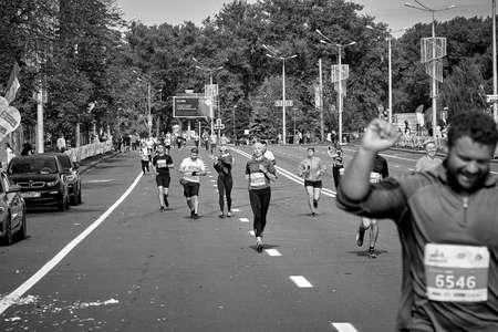 September 15, 2019 Minsk Belarus Happy participants run along the city road of the half marathon in Minsk