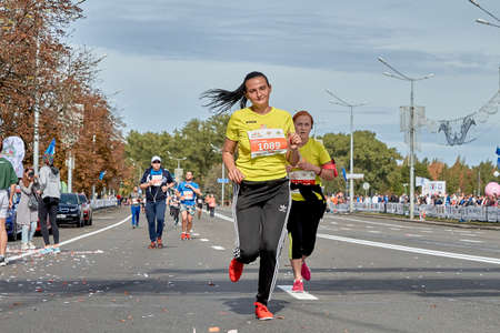 September 15, 2019 Minsk Belarus A marathon race in which two active participants run on a city road Editorial