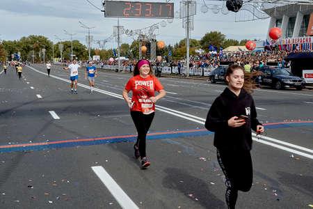 September 15, 2019 Minsk Belarus A marathon race in which two women cross the finish line on a city road