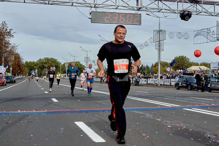 September 15, 2019 Minsk Belarus A marathon race in which a Mature athlete with glasses runs along the road