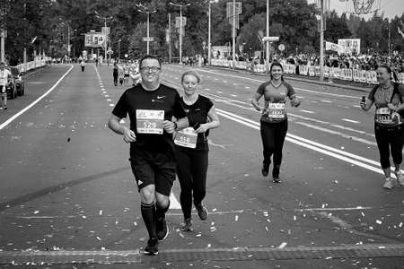 September 15, 2019 Minsk Belarus In black and white, a marathon race in which lucky participants run to the finish line Éditoriale