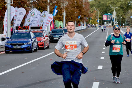 September 15, 2019 Minsk Belarus An athlete runs to the finish of the marathon ahead of a woman
