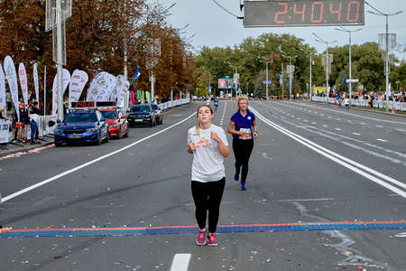 September 15, 2019 Minsk Belarus A marathon race in which an active woman crosses the finish line on a city road
