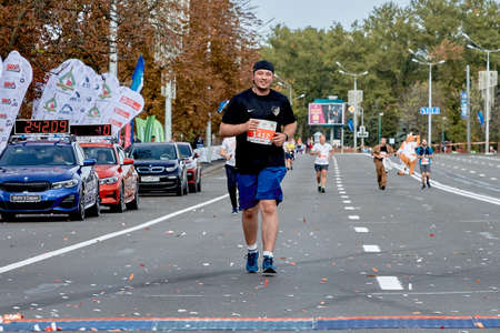 September 15, 2019 Minsk Belarus A marathon race in which a happy participant runs to the finish line on a city road