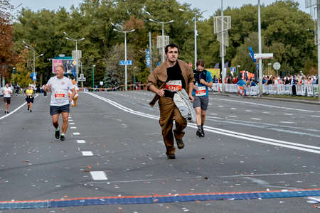 September 15, 2019 Minsk Belarus Active participants of a marathon run on a city road Editorial
