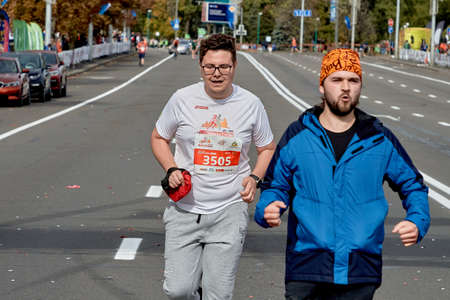 September 15, 2019 Minsk Belarus A marathon race in which two marathon participants run in close-up on a city road Editorial