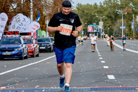 September 15, 2019 Minsk Belarus Minsk hosts a half-marathon where a close-up of a happy athlete crosses the finish line