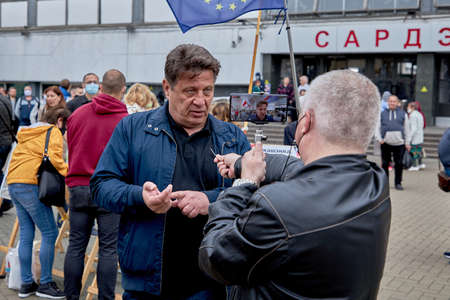 June 14 2020 Minsk Belarus A close-up of a possible presidential candidate Nikolai Kozlov explains to a blogger why life is bad
